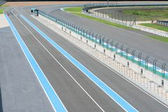 Asphalt road Vehicle track with fence in outdoor circuit, Race track with curve road for car racing. Race track with curve road for car racing stock photos