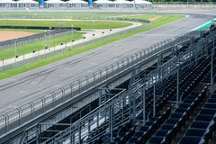 Asphalt road Vehicle track with fence in outdoor circuit, Race track with curve road for car racing. Race track with curve road for car racing stock images