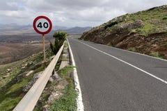 Asphalt road in volcanic mountain landscape Stock Images