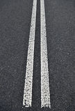 Asphalt road with white double Royalty Free Stock Photos