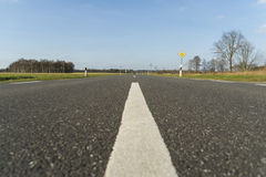 Asphalt road with white line and blue sky Stock Image