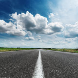Asphalt road with white line under dramatic sky and cl Royalty Free Stock Photo