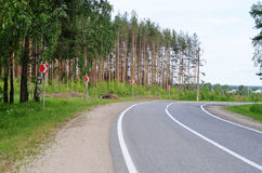 Asphalt road with a white marking Stock Photos