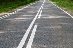 Asphalt road with a white marking Stock Photo