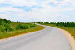 Asphalt road with a white marking Royalty Free Stock Image