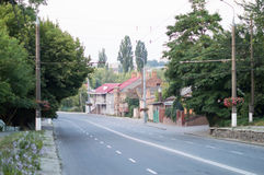 Asphalt road with white markings on city street Royalty Free Stock Images