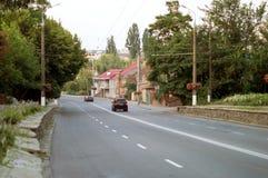 Asphalt road with white markings on city street Stock Photo