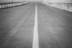 Asphalt road with white stripes Royalty Free Stock Images