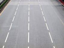 Asphalt road with white stripes Stock Photo