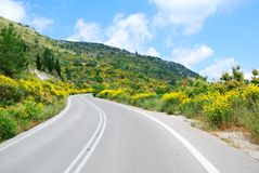 Asphalt road winding through hills Stock Photo