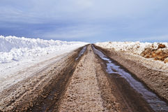 Asphalt Road With Dirty Snow In Early Spring Stock Images