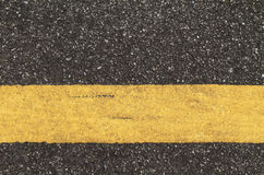 Asphalt road with yellow line Royalty Free Stock Photo