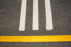 Asphalt road, yellow line on the road. Asphalt road, yellow line on the road,Thailand Stock Photos