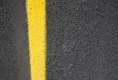 Asphalt road with yellow paint Stock Photography