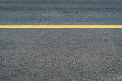 Asphalt road with yellow sign line Royalty Free Stock Images