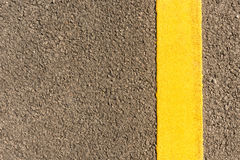 Asphalt road with yellow stripes Stock Photos