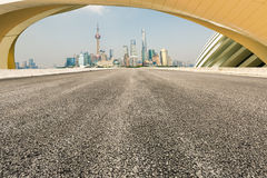 Asphalt roads and abstraction of modern architecture. Background Stock Image