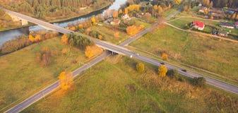 Asphalt roads crossed. And autumn trees, rural landscape Stock Images