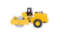 Asphalt roller. Toy asphalt roller isolated on white stock photos