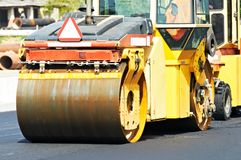Asphalt roller compactor at work Royalty Free Stock Photography