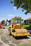 Asphalt roller on gravel Stock Photos