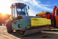 The asphalt roller is parked with other construction equipment royalty free stock photos