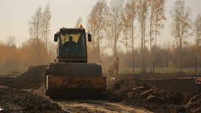 Asphalt roller rams land 2 stock video footage