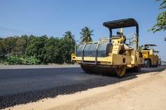 An asphalt roller. On asphalt asphalt rider there an asphalt roller to keep everything well pressed Stock Photos