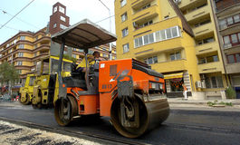 Asphalt roller in road construction site Royalty Free Stock Photo