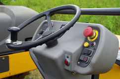 Asphalt roller steering wheel and start up controls. Detail Stock Images