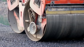 Asphalt roller working on the street that was recently repaired stock video footage