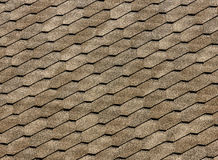 Asphalt roof shingles - roofing construction, roofing repair. for background or texture.  Royalty Free Stock Image