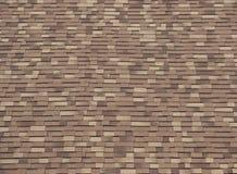 Asphalt roof shingles of three shades of brown. Wood look. Asphalt roof shingles of three shades of brown, wood look stock photo