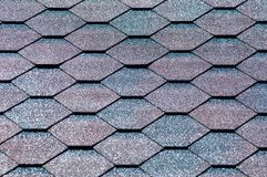 An asphalt shingle is a type of wall or roof shingle that uses a. Sphalt for waterproofing. They are one of the most commonly used roofing covers in North royalty free stock images