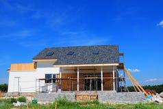 Asphalt Shingles Roofing Construction. House Construction with asphalt shingles roof, skylights, terrace patio. Attic skylight stock photos