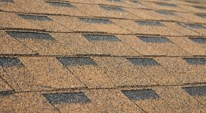 Asphalt Shingles Soft Focus Photo. Close up view on Asphalt Roofing Shingles Background. Roof Shingles - Roofing Construction. Roofing Repair Royalty Free Stock Image