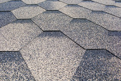 Asphalt Shingles Soft Focus Photo. Close up view on Asphalt Roofing Shingles Background. Roof Shingles - Roofing Construction, Roofing Repair Royalty Free Stock Photos