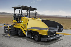 Asphalt spreader machine on the road Royalty Free Stock Photography