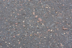 Asphalt with stones Royalty Free Stock Photos