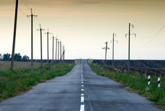 Asphalt street. In the middle of agricultural field Stock Photography