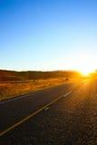 Asphalt and Sunrise Stock Images