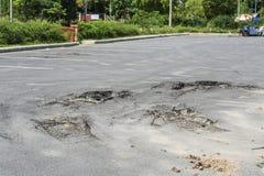 Asphalt surface on the car park was demolished due Stock Images