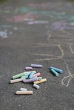 Asphalt surface covering with sidewalk chalking drawings Royalty Free Stock Image