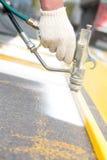 Asphalt surface marking works Stock Photo