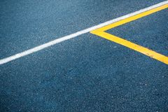 Asphalt surface with white and yellow lines royalty free stock photo