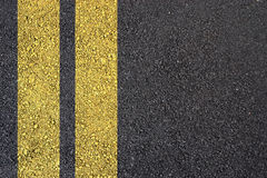 Asphalt surface with yellow line Royalty Free Stock Image