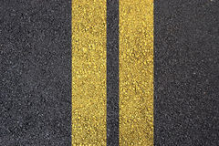 Asphalt surface with yellow line Stock Photo