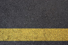 Asphalt surface with yellow line Stock Image