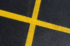Asphalt surface with yellow line Stock Photos