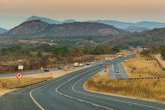Asphalt tar road at sunset in South Africa Stock Images